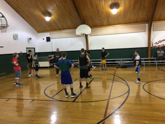 Immanuel Lutheran boys basketball coach Charles Jennings talks with his team at practice Wednesday at Immanuel Lutheran School gymnasium.