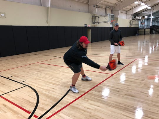 Former NFL and Wisconsin lineman Mark Tauscher is among a growing number of people in the U.S. playing pickleball.