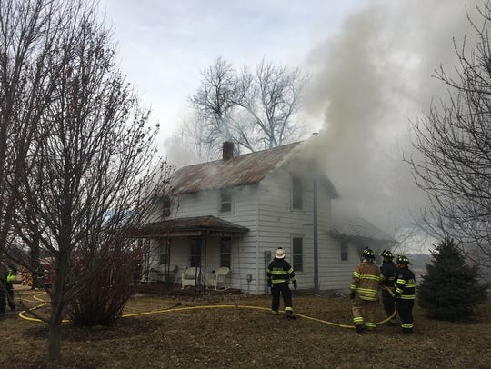 Firefighters are shown battling a fire at 3867 James