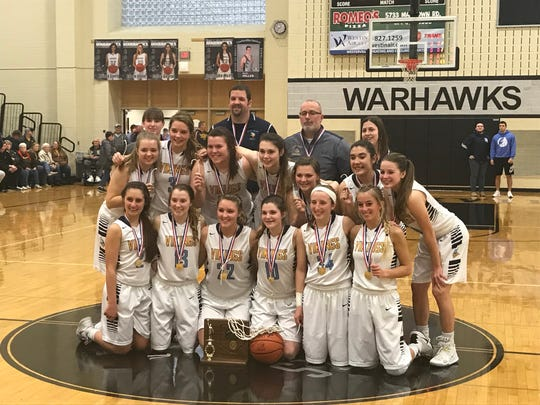 The River Valley girls basketball team poses after