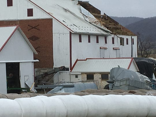 High winds tore off a section of a barn roof on Loudon