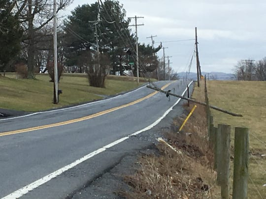 High winds toppled a utility pole on Loudon Road in St. Thaoms Township on Friday, March 2, 2018.