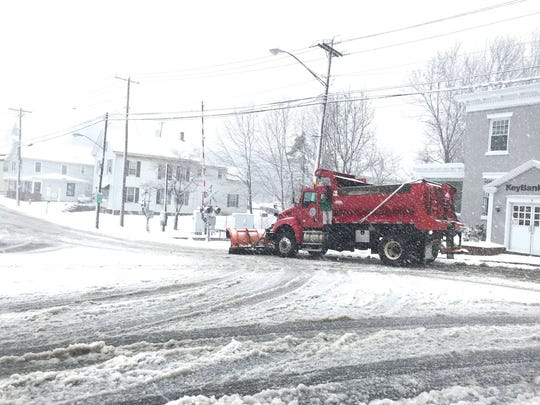 Plow trucks at work in downtown Pawling.