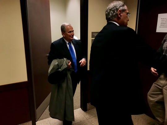 Former state Sen. George Maziarz, left, enters a courtroom