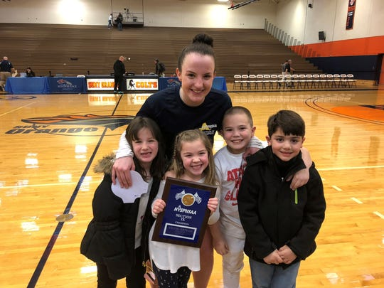 Highland basketball star Bri Rozzi poses with her nieces and nephews after winning the Section 9 Class B title.