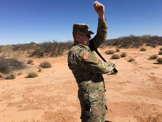 Spc. Karl Pearson demonstrates how to put on a tourniquet