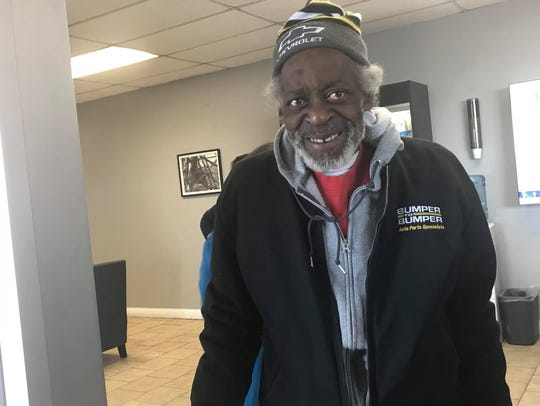 Joe Booth, 69, smiles as he gets ready to board his