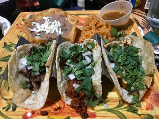 The taco dinner ($13.75) with a steak, chicken and