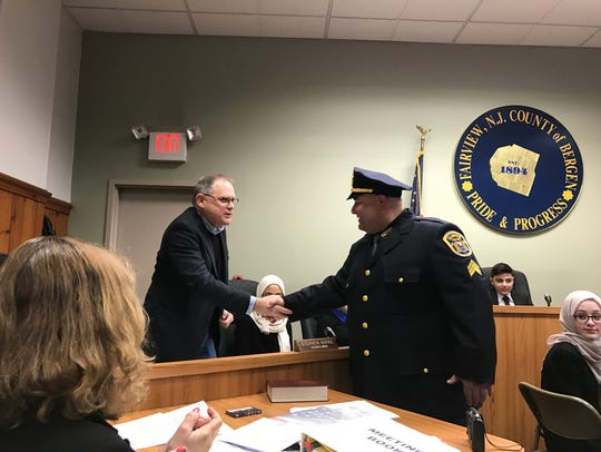 Councilman Stephen Burke congratulating the newly promoted