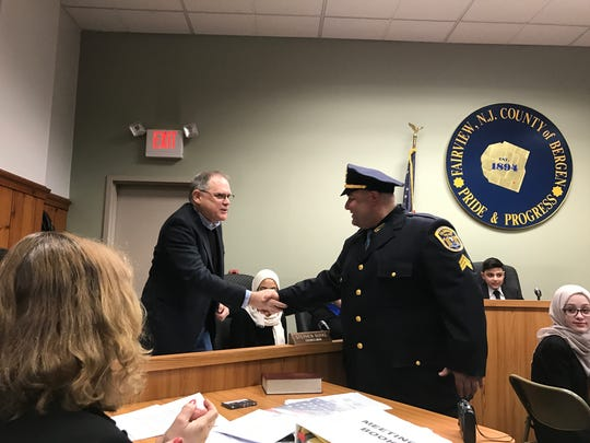 Councilman Stephen Burke congratulating the newly promoted Sgt. Albert Napolitano at the Fairview council meeting March 5.