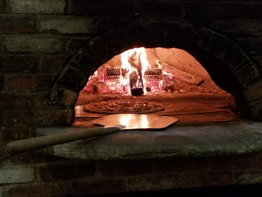 Authentic wood-fired pizza is made at Francesca Brick
