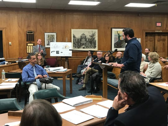 Millburn resident Alex Moaba asks questions about  the application for constructing an Exxon gas station and all-night 7-11 convenience store at the intersection of Millburn Avenue and Vauxhall Road.