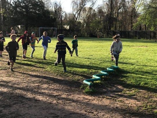 Montessori Educational Center students run laps before