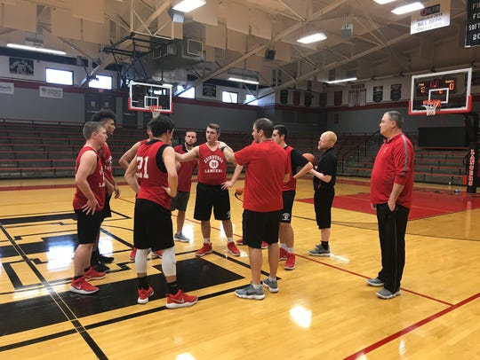 Witty goes over somethings as the team wraps up practice.