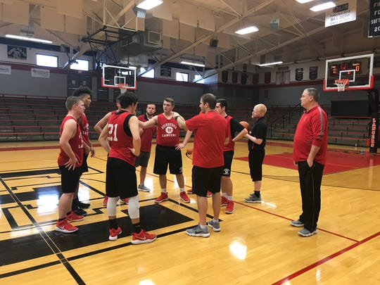 Witty goes over somethings as the team wraps up practice. The Lancers will take on Central Christian this Saturday at 10 a.m.