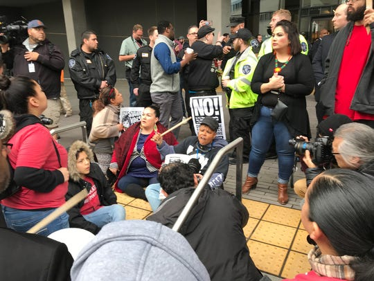 Protesters chant outside the Kimpton Sawyer Hotel on