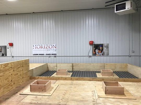 Simulated roofing areas with roof penetrations for HVAC equipment give students at Horizon Roofing's training center a space to practice detailed roofing techniques.