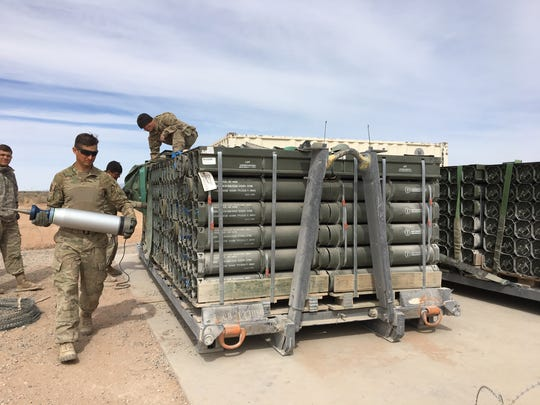 Soldiers reload ammunition for another round of gunnery