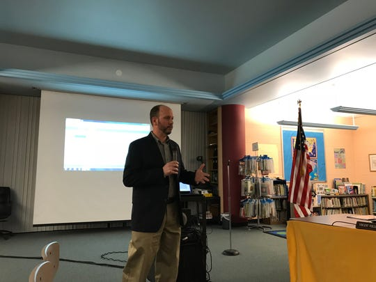 Raymond Bailey, COO of Share911, demonstrates the software's emergency notification capabilities on March 6, 2018, at the Cedar Grove Board of Education meeting.