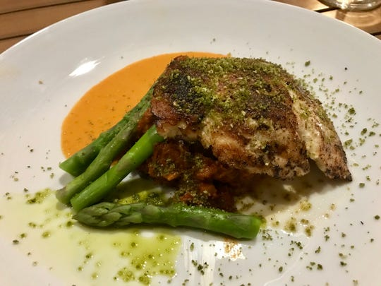 Seared grouper with asparagus and chorizo hash from Fish Tale Waterfront Dining Fort Myers Beach.