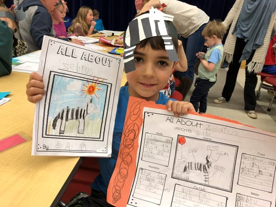 Zebras were very interesting animals for Sam Bunting to research. He had fun making his headband to match his book and poster.