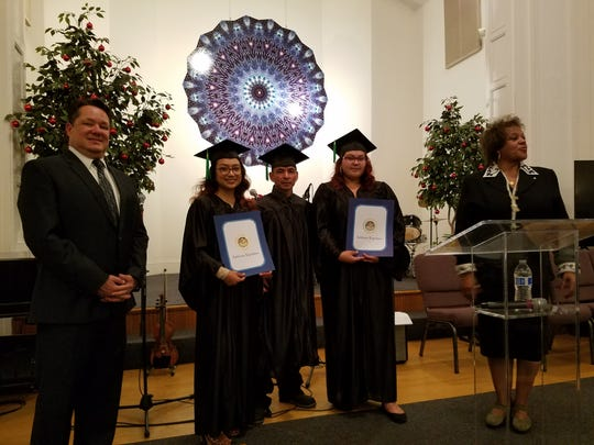 Placencia (center) was recognized by Assemblymember with the Transitions Mentorship in Training and Leadership Award from the Transitions for Recovery and Re-Entry Program Inc. in December 2017.