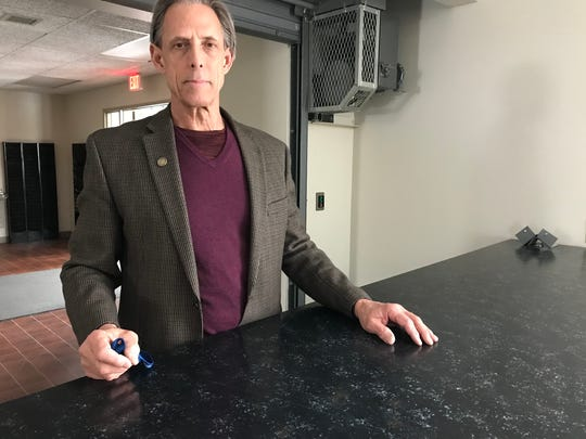 Minnehaha County auditor Bob Litz poses for a photo inside of the former jail and sheriff's building at 220 W. 6th Street that will be used as temporary election space during the upcoming city-school board election.