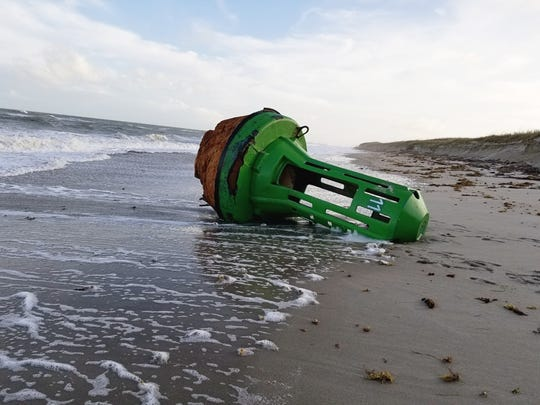 Melbourne photographer Kelly Bouchard stumbled upon this large green buoy Nov. 13 south of 2nd Light Beach at Patrick Air Force Base.