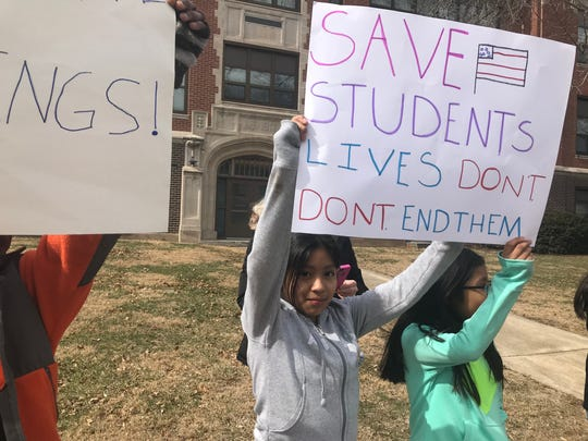 As part of a protest against gun violence, Mann Elementary students walked out of class and held posters by the side of the road for 17 minutes early Friday afternoon. The 17 minutes represented the victims of the Parkland school shooting in February.