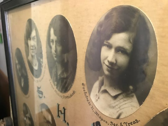 Gretchen Mapes' 1929 Sunfield High School class photo hangs with others in the Sunfield Historical Society Welch Museum. The photo helped Vee Grimwood track down her family after she found Mapes' class ring half-buried in the dirt 30 years ago.