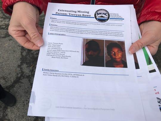 Volunteers take flyers to door-to-door, searching in