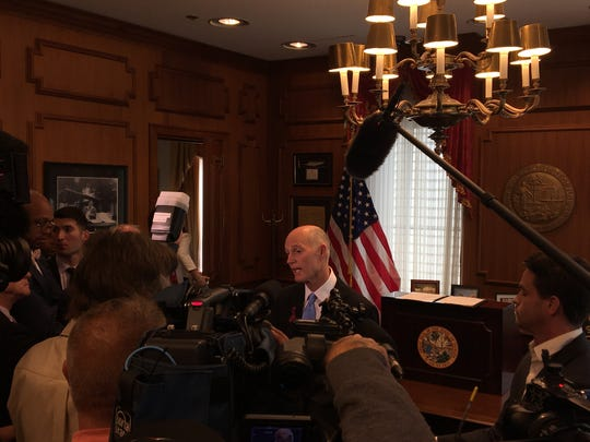 Gov. Rick Scott signs a school safety bill at the Capitol