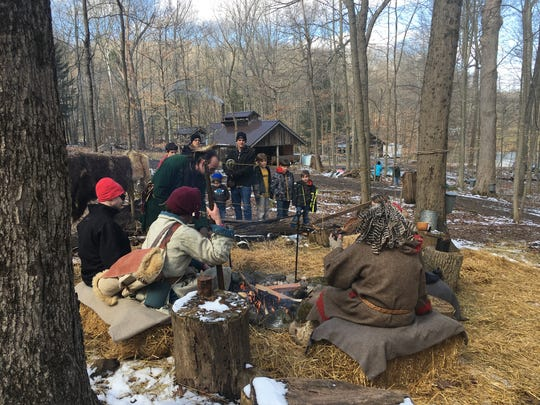 Demonstrations at Malabar's Maple Syrup Festival Saturday included how Native Americans made sap into syrup.