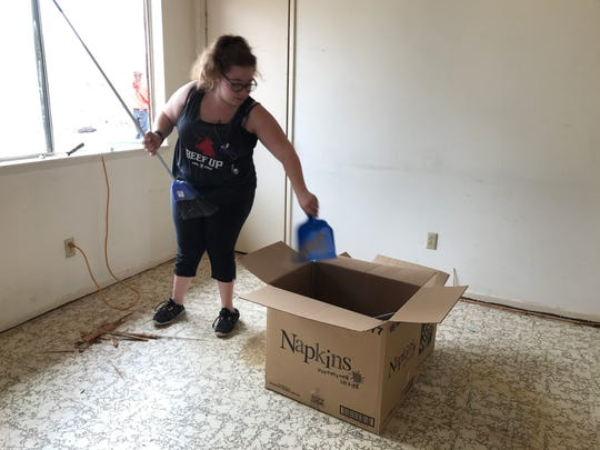 Anica Korcha, 18, is one of dozens of people who volunteered Saturday, March 10, 2018, to clean up a long-vacant house being purchased for a Joshua Tree family found living in a makeshift shelter.