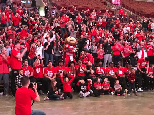 The Ohio State men's basketball team and fans react