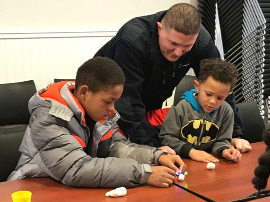 A parent watches as his youths learn about Thomas Edison, batteries and circuitry on Saturday, March 10, 2018 in West Orange.