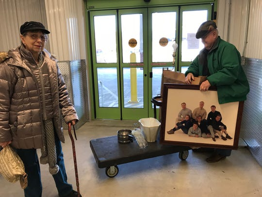 Anne and Rod Foley recently downsized from their Westwood house, and they keep their belongings in self-storage. Here, they pick up a few things to decorate their new apartment.