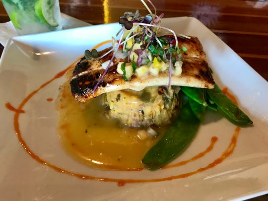 Bronzed mahi over a plantain cake with Key lime beurre