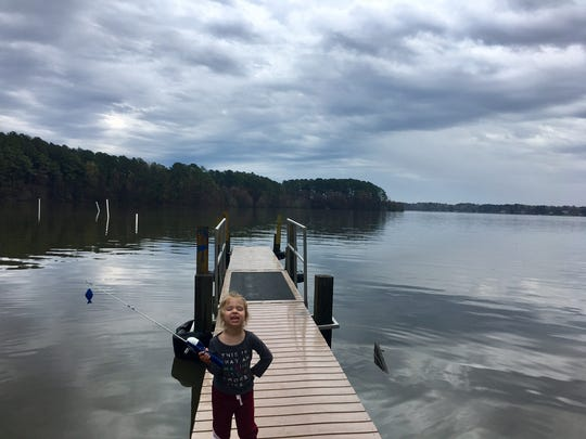 """Avery Guidry, 3, shows off her """"catch"""" at North Toledo Bend State Park."""