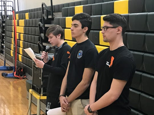 Montville High School students read tributes to individual victims of the Parkland, Fla. school shootings during a staged walkout in the school gym on March 14, 2018.