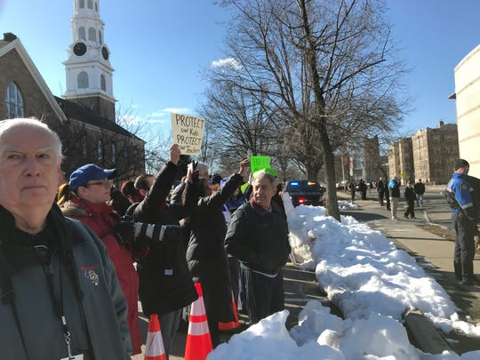 Parents on Broad Street observe as Bloomfield High School students participate in a nationwide walkout on March 14, 2018, in remembrance of the 17 victims killed in the Parkland, Florida, high school.