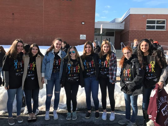 """Verona High School students wear George Cortese's """"People Over Guns"""" T-shirts on March 14, 2018, as part of the national school walkout, impelled by the Florida killings the month before."""