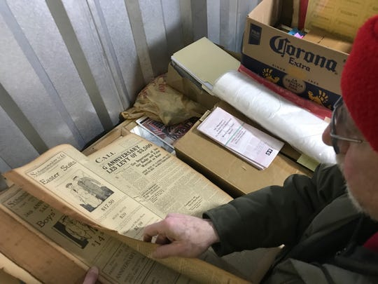 Mered Frankel, the chair of the Pompton Lakes Historical Preservation Commission, looks through the collection of items the commission keeps in a storage unit.