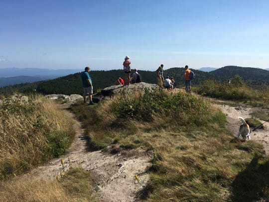Hikers enjoy the view from Black Balsam in the Shining
