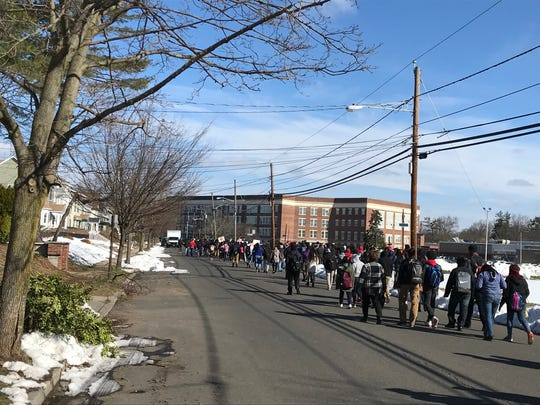 Students at Plainfield High School walking out of class Wednesday morning as part of a nationwide student protest calling for gun control in the wake of the Parkland school shooting one month ago.