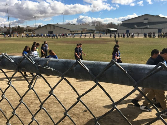 Students outside Swope Middle School in Reno take part in a national walkout Wednesday, March 14, 2018.