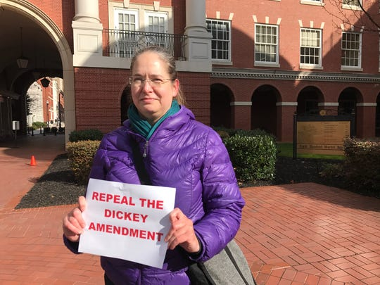 """Former Central High School teacher Leslie Gordon protested the Dickey Amendment outside Congressman John Duncan's office in downtown Knoxville. The Dickey Amendment, attached to a 1996 spending bill, mandated that funds for Centers for Disease Control injury prevention could not be used """"to promote gun control,"""" a move Gordon said has prevented the CDC from researching the gun violence in the country."""