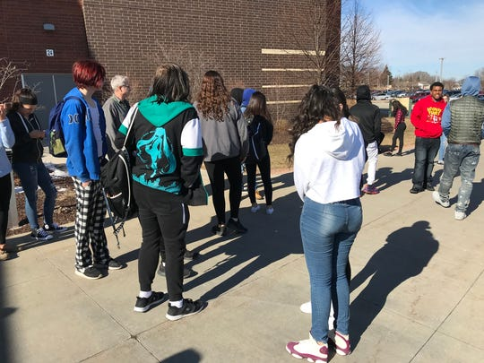 About 25 Greenfield High School students joined in the National School Walkout March 14.