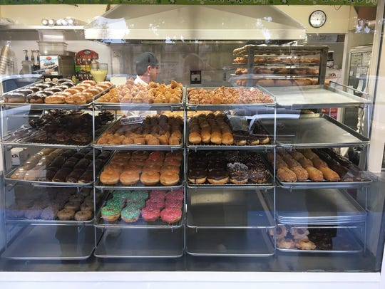 An array of doughnuts greets patrons at Rolling Pin