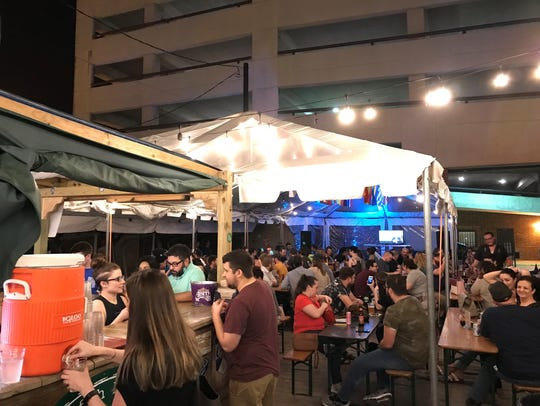 People crowd in and around the tent at Biergarten for